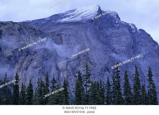 Mountain ridge with cloud cover and snow patched, Athabasca Pass, Jasper National Park