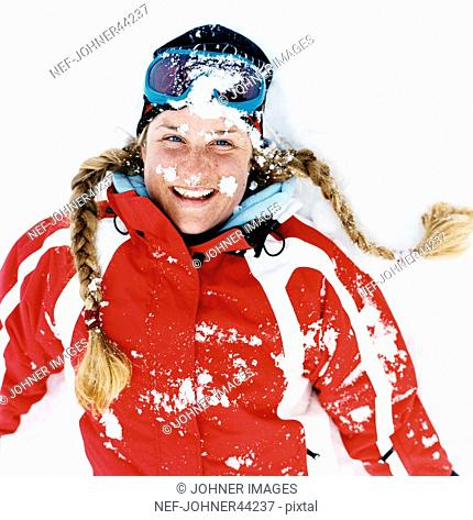 Woman with braids and red jacket is attacked with snowball fights