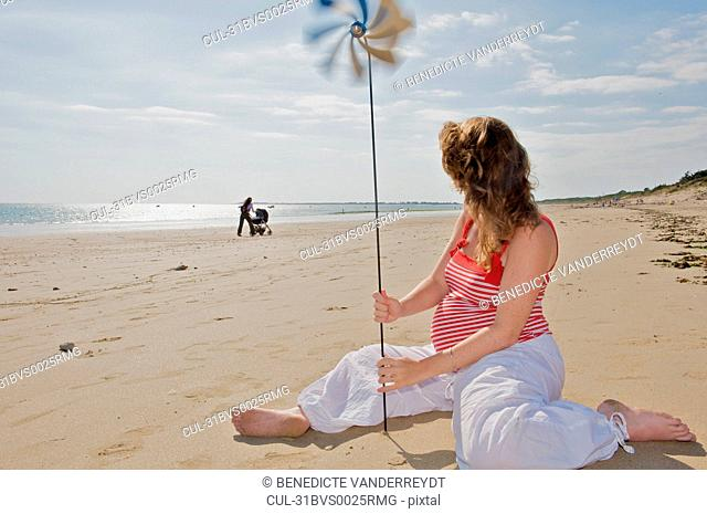 Pregnant woman watching a mother & baby