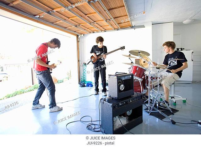 Three teenage boys 16-18 in garage band