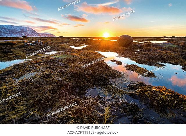 Sun setting over the gulf of St Lawerence, Rocky Harbour, Gros Morne National Park, Newfoundland and Labrador