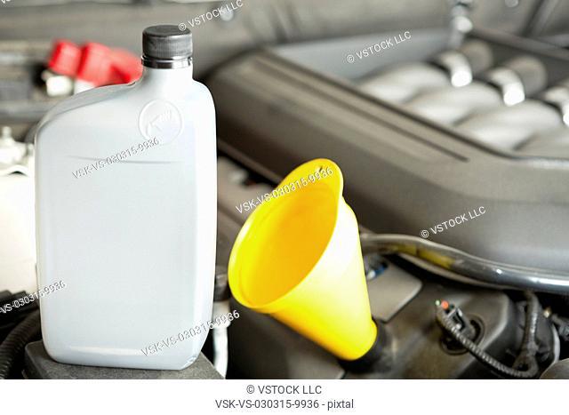 Plastic oil bottle on car