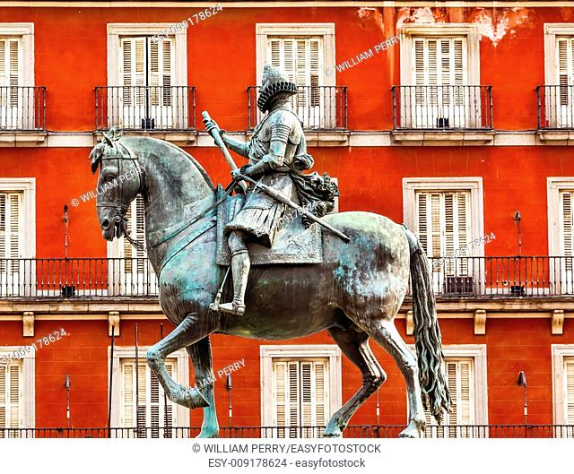 Plaza Mayor Built in the 1617 Famous Square Cityscape Madrid Spain. King Philip III Equestrian Statue created in 1616 by Sculptors Gambologna and Pietro Tacca