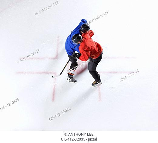 Overhead view hockey opponents colliding