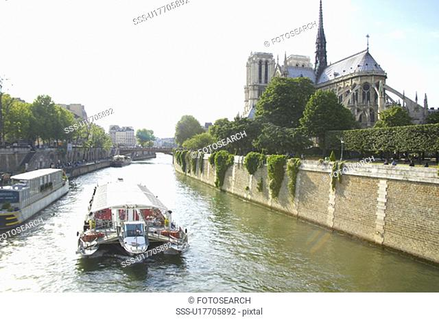 Boat on the Seine River with the Notre Dame Cathedral to the right