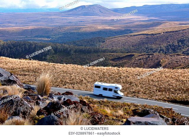 NATIONAL PARK, NZ - NOV 25 2014:Campravan drive through Tongariro National Park.About 1M people visit the park every year, doing hiking and climbing in summer