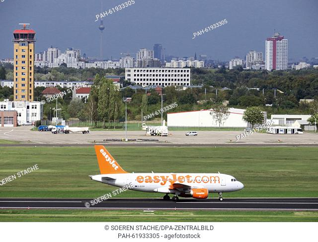 An Easyjet airplane just arrived on the landing strip behind the future terminal and drives to the parking spot on the Berlin Brandenburg Airport BER in...