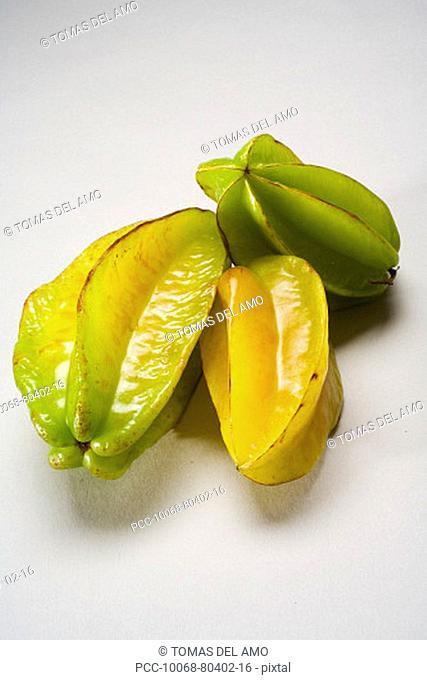 Studio shot of three starfruit