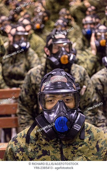 US Marine recruits are trained in proper use of their gas mask during bootcamp January 13, 2014 in Parris Island, SC