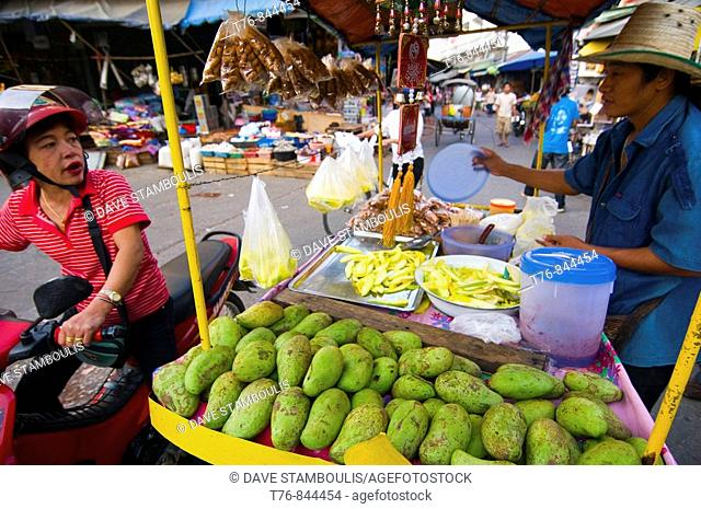 wide angle view of green mango seller in the market of Mae Sot Thailand