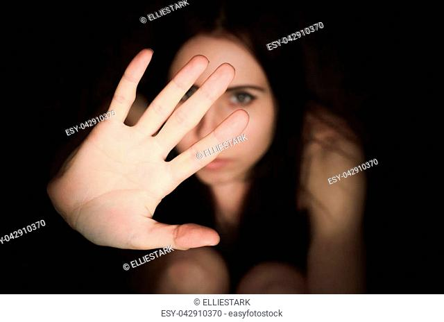 Young woman shows gesture of stop harassment and violence