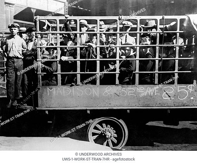 Chicago, Illinois: July 31, 1919 Passengers and workers resorting to riding in trucks put into serivice during the street car strike