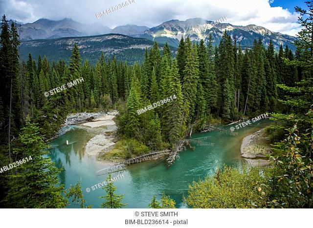 Bending river near mountain range