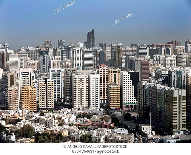 United Arab Emirates Abu Dhabi. Modern skyscrapers and typical arab houses