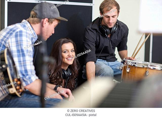 Young musicians taking a break in recording studio