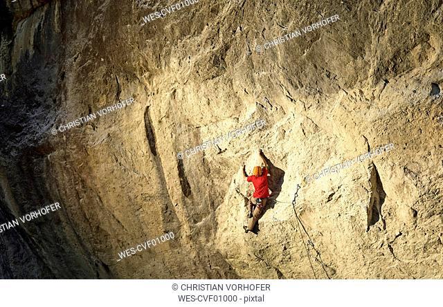 Austria, Innsbruck, Martinswand, man climbing in rock wall