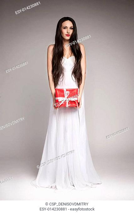Gorgeous woman holding gift