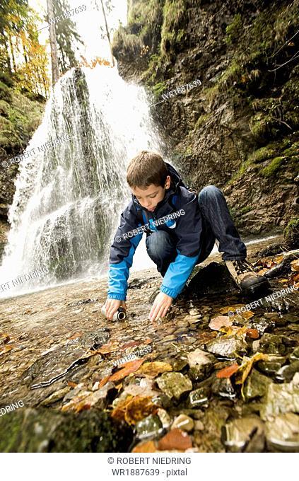 Boy Filling Water Bottle, Bavaria, Germany, Europe