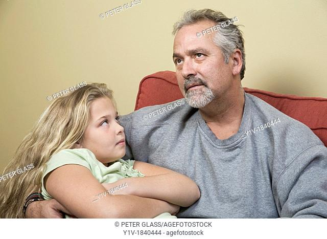 Young blonde girl and her father