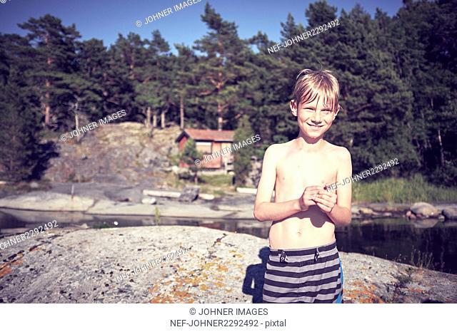 Boy by lake