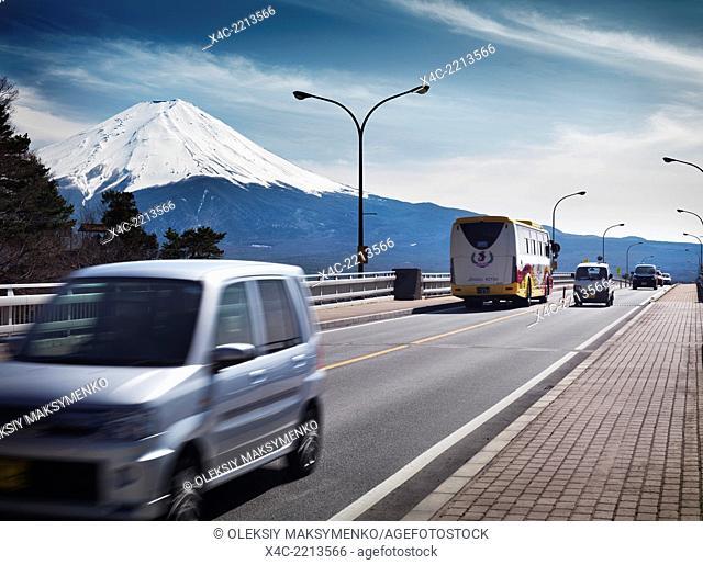 Cars on a bridge at Fujikawaguchiko with Mount Fuji in the background. Yamanashi, Japan