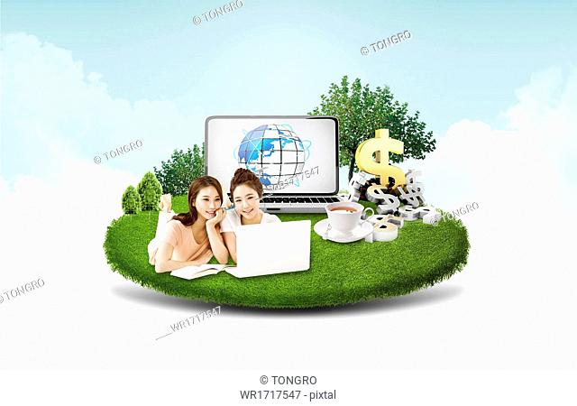 Two women using a laptop