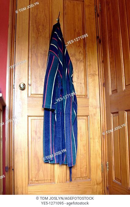 Dressing gown hanging on back of bedroom door