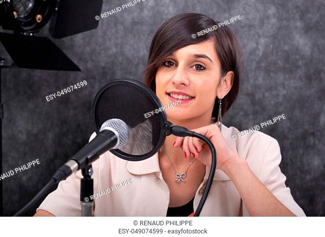 a young woman working on the radio