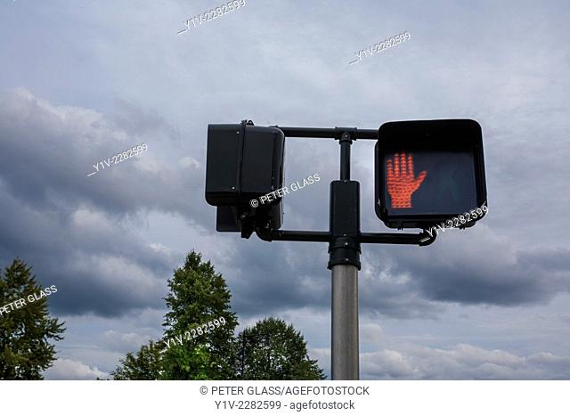 Pedestrian crossing light showing a red hand