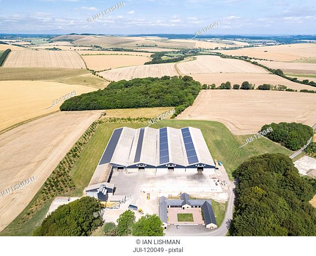 Aerial landscape of farm buildings and harvested summer wheat and barley fields