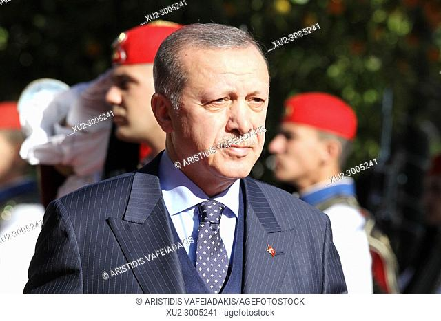 Turkey's President Recep Tayyip Erdogan reviews the Presidential Guard with Greece's President Prokopis Pavlopoulos, during the welcome ceremony in Athens
