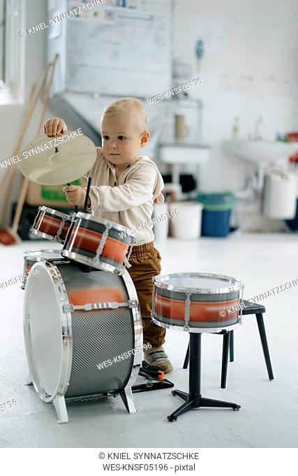 Toddler with toy drums