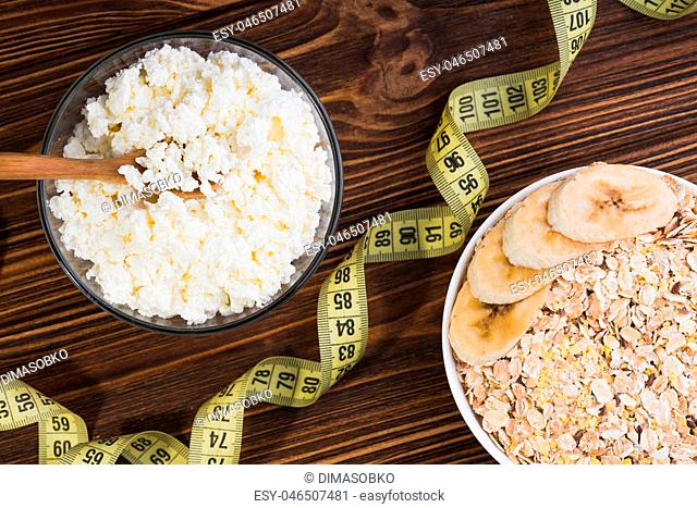 Fresh cottage cheese in a glass bowl. Diet background. healthy food