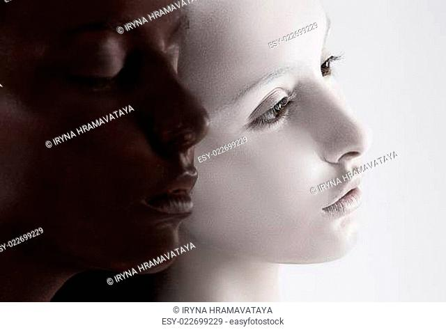 Cultural Diversity. Two Faces Colored Black & White. Yin Yang Style
