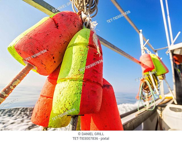 Lobster buoys tied to railing