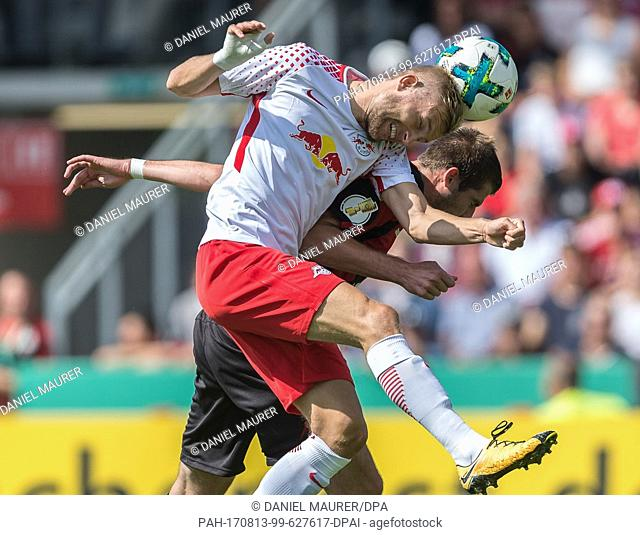 Dorfmerkingen's Daniel Nietzer (R) and Leipzig's Konrad Laimer vie for the ball during the German Football Association (DFB) Cup first-round match between...