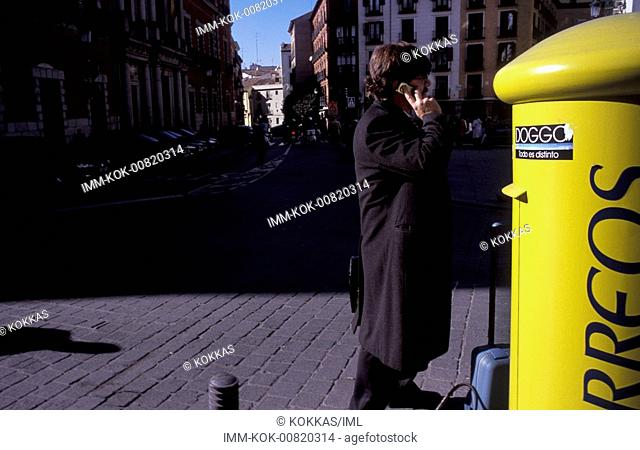 City center, man talking on mobile , Madrid, Spain, Europe