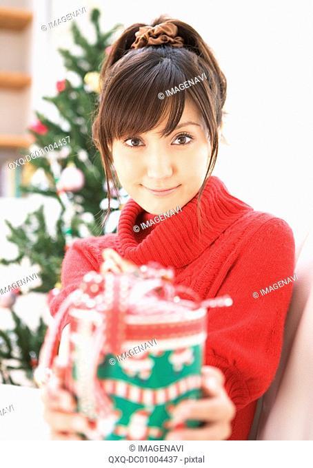 A woman giving Christmas present