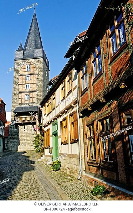Alley and church spire in Quedlinburg, UNESCO World Heritage Site, Saxony-Anhalt, Germany, Europe