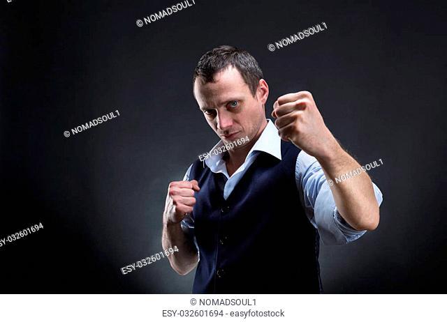 Fighting businessman over grey background