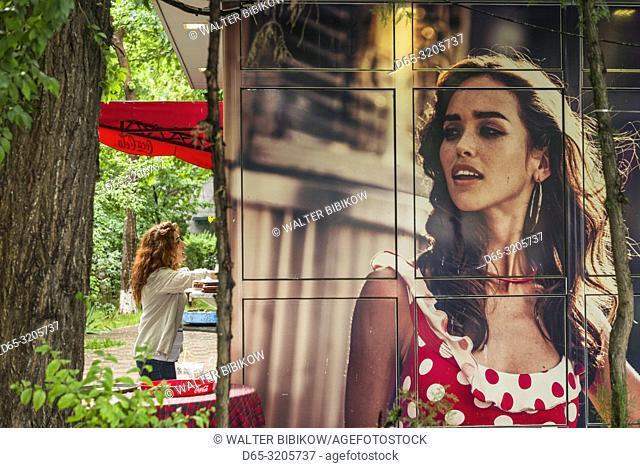 Armenia, Yerevan, outdoor bar mural with waitress, NR