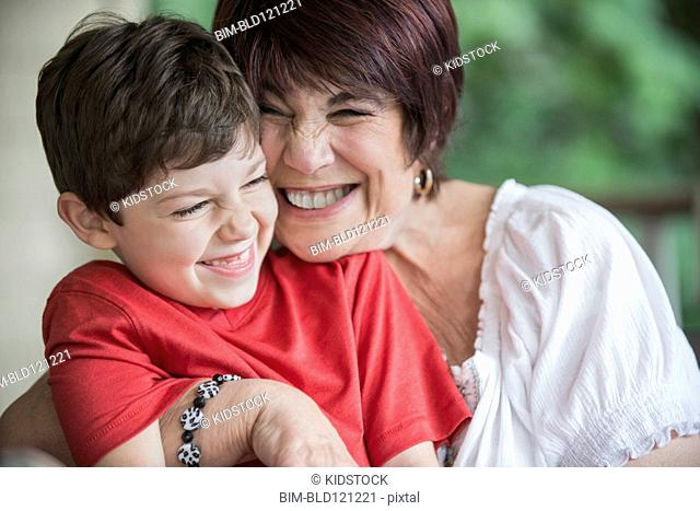 Caucasian woman hugging grandson