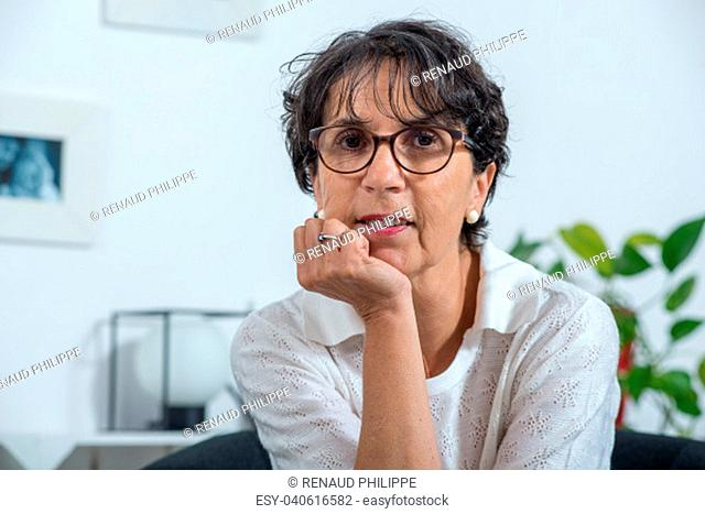 a portrait of a beautiful mature woman at home