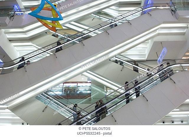 Escalators in shopping mall