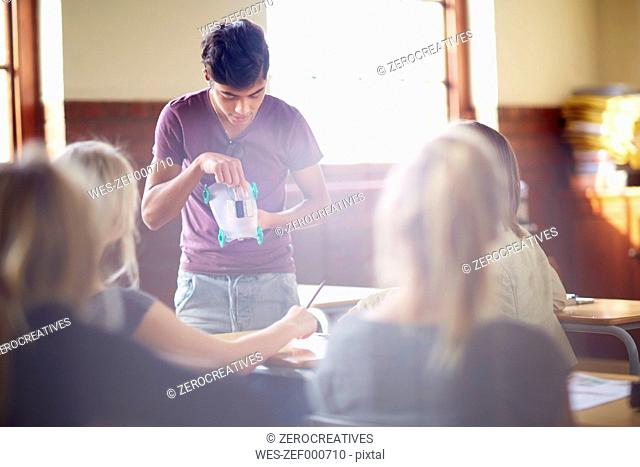 Student holding a presentation in classroom
