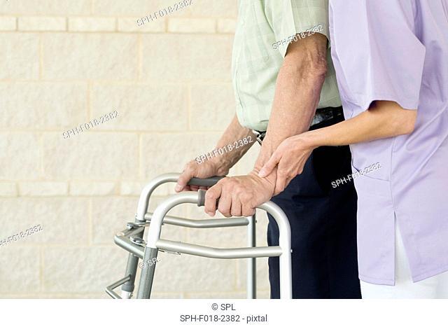 Senior man using walking support frame