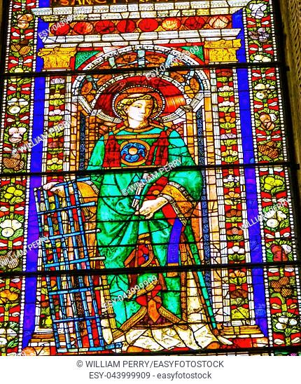 Saint Laurentius of Rome Stained Glass Window Chapel Santa Maria Novella Church Florence Italy. Church founded 1357. Saint killed Roman Emperor 259