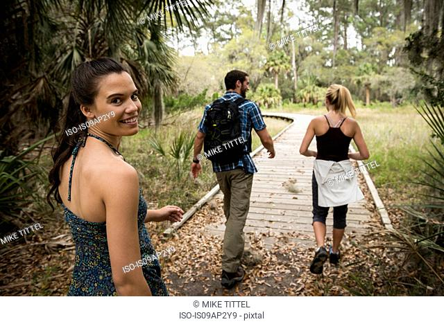 Hikers on walkway, Skidaway Island State Park , Savannah, Georgia, USA