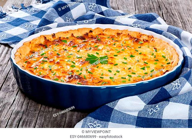 French onion quiche or pie in a gratin dish, traditional recipe, view from above