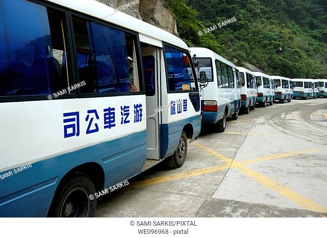 Line of tourist buses parked on Mount Hua, one of China's five Sacred Taoist Mountains, in Shaanxi, China